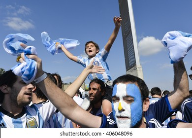 BELO HORIZONTE, BRAZIL - June 26, 2014: Fans vibrating and jumping during the FIFA 2014 World Cup. Argentina is facing Iran in the Group F at Minerao Stadium