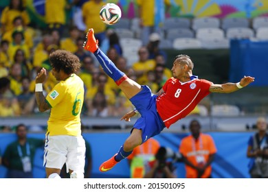 BELO HORIZONTE, BRAZIL - June 28, 2014: Marcelo of Brazil and Arturo Vidal of Chile during the 2014 World Cup Round of 16 game between Brazil and Chile at Mineirao Stadium. NO USE IN BRAZIL.