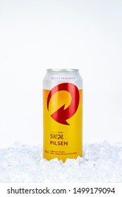 BELO HORIZONTE, BRAZIL - SEPTEMBER 08, 2019: Skol pilsen beer can background isolated on white, Skol is the most popular beer in Brazil, Lager chopp pilsen Brasileira, 473ml,