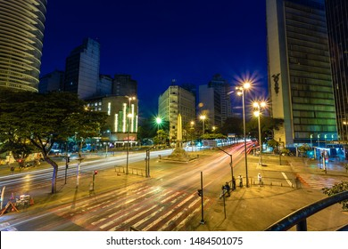 Belo Horizonte/MG/Brazil - Aug 18th 2019: Long exposure of traffic light trails on Downtown BH with the Obelisk in September 7th Square (Praça Sete de Setembro) at night.