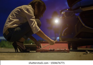 belonging tools box prepare by driver woman, need help and assistant at dark of the night, scary and worry alone in the dark, car engine failure or tire need replacement