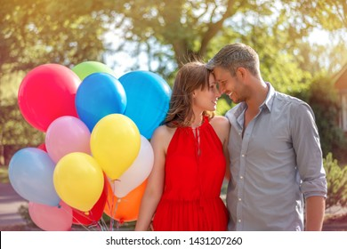 beloved couple outdoors holding balloons