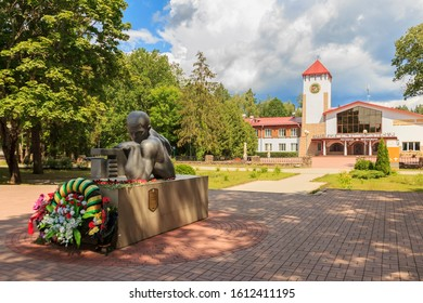 Belovezhskaya Pushcha, Belarus -  Jun 2019. gate in Belovezhskaya Pushcha. On pedestal is warrior lying behind symbolic machine gun. inscription Comrade! Bare your head and bow reverently. monument