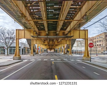 Below the elevated train tracks in the city. Lake Street in the Fulton Market West Loop neighborhood. Main streets in Chicago, streets in Illinois.