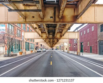 Below the elevated train tracks in the city. Lake Street in the Fulton Market neighborhood. Main streets in Chicago, streets in Illinois.