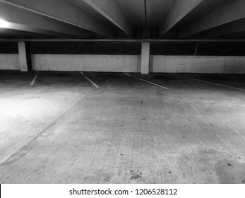 A below grade parking garage early in the morning.