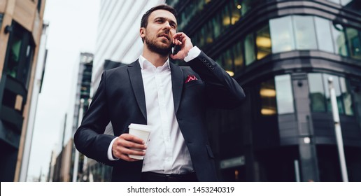 Below view of business analytic expert phoning to partner for communicate during coffee break in financial district using 4g roaming international connection, concept of operator mobile conversation