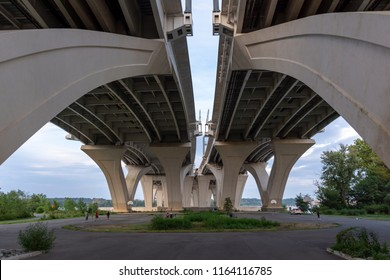 Below the Woodrow Wilson Memorial Bridge, which spans the Potomac River between Alexandria, Virginia, and the state of Maryland, as seen from Jones Point Park in Alexandria.