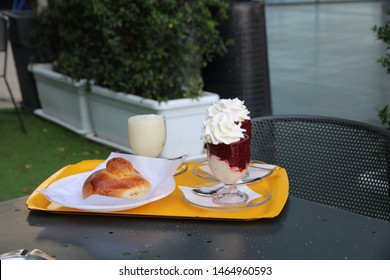 Belpasso - Italy / July 26, 2019. The snack bar Prestipino in the shopping mall Etnapolis served this traditional Sicilian breakfast, composed of granita (fruit ice slurry) and brioche (kind of bread)