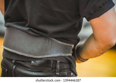 A belt to help maintain the back bone while exercising to lift weights. Enter the fitness zone to build strong muscles  and good health. Selective focus
