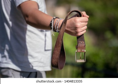 A belt is indeed a very effective weapon.  Forced To Someone With A Belt. Teen strikes a belt in his hand.