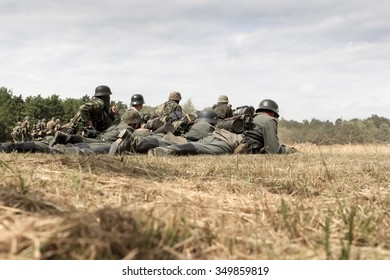BELTRING, UK - JULY 23, 2010:  World War 2 German troops lie down on battlefield at the War and Peace Event at Hop Farm