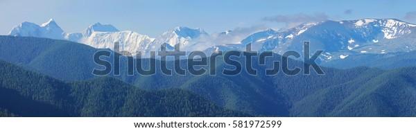 Beluga and snow-capped peaks of the Altai, panorama mountain