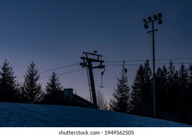 Belveder hill over Zelezna Ruda town with ski slope and ski lift in sunrise morning - Shutterstock ID 1949562505