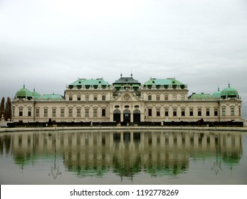 Belvedere Palace reflected in the water in a foggy day, Vienna, Austria