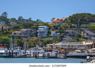 Belvedere, USA: June 23, 2018 : A view of a marina in front of luxury residential homes that built on the coastline and on hillsides in the city of Belvedere