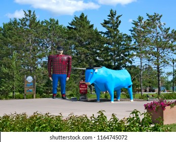 Bemidji, Minnesota - July 24, 2018: Paul Bunyan and Babe the Blue Ox, popular, often photographed road side attraction statues of the legendary lumberjack and his sidekick.
