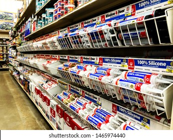BEMIDJI, MN - 29 JUL 2019: Display racks of silicone caulk sealant in hardware department of retail store.