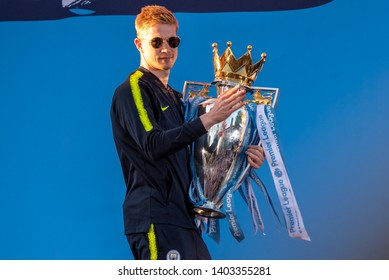 © Ben Earlam - 20/05/2019. Manchester, UK. Players from Manchester City football club parade down Deansgate in an open top bus and show off the trophy outside the cathedral. Photo credit : Ben Earlam