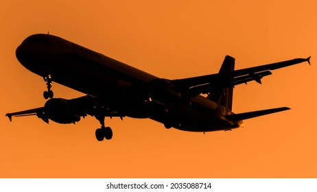 Ben Gurion Airport, Israel - July 20, 2015: silhouette of an Alitalia Airbus A321 plane lands at Ben Gurion Airport