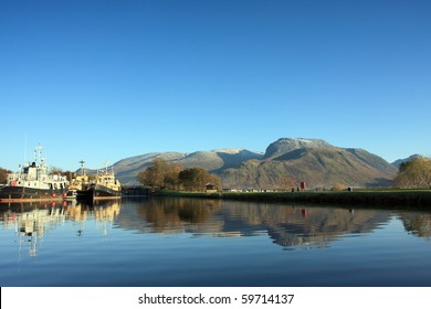 Ben Nevis reflected in the Caledonian Canal in the Scottish Highlands.