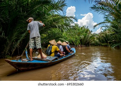 BEN TRE, VIETNAM - 21 May 2017, A traditional boat with tourists floats through the jungle of the Mekong Delta near Ben Tre, Vietnam