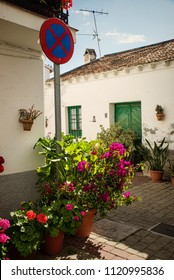 Benagalbon old town, a traditional Andalusian location full of narrow streets and flowerss
