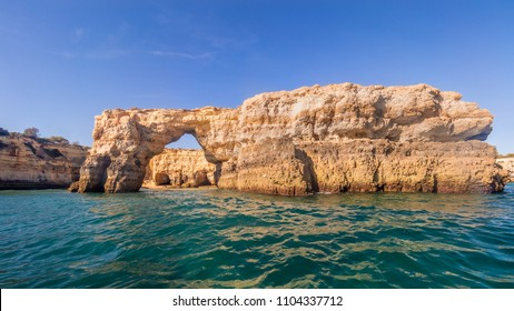 Benagil caves, holidays in Algarve, Portugal, speed boat trip from Albufeira to Benagil caves, blue sky, sea, cliffs and rocks