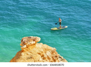 BENAGIL, PORTUGAL - NOVEMBER 3, 2017.Man and surf on  Algarve beach , amazing destination in portugal and  all seasons attraction for many tourists in entire world.