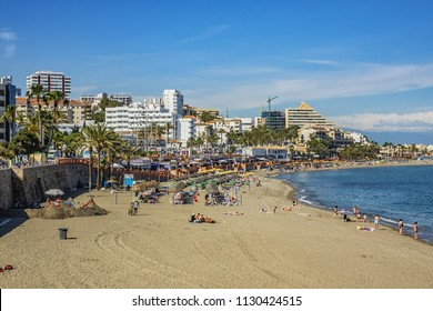 BENALMADENA, SPAIN - JUNE 1, 2018: View of the beautiful beach and the sea shore of resort town Benalmadena. Benalmadena - most popular holiday towns on the Costa del Sol.