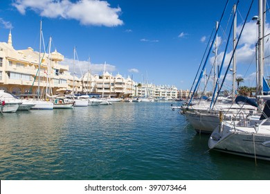 BENALMADENA, SPAIN - MARCH 5, 2016: Docked boats at Puerto Marina harbor in Benalmadena, Spain. Puerto Marina is one of the biggest leisure ports in Andalusia, and is located at Costa del Sol.