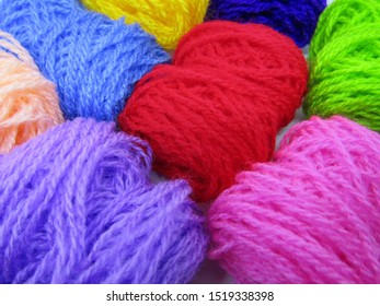 Benang wol rajut or roll knitting wool yarn in various colorful multi colored dye. Made from  natural or synthetic fibers. Detail texture pattern close up view microfiber ball loop waves shape fabric.