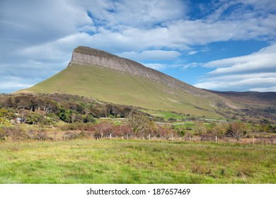 """Benbulben is a large rock formation in County Sligo, Ireland.  It is part of the Dartry Mountains, in an area sometimes called """"Yeats Country"""""""