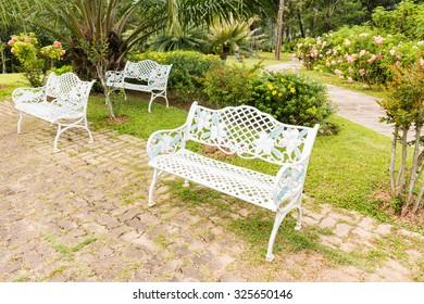Bench in beautiful garden background