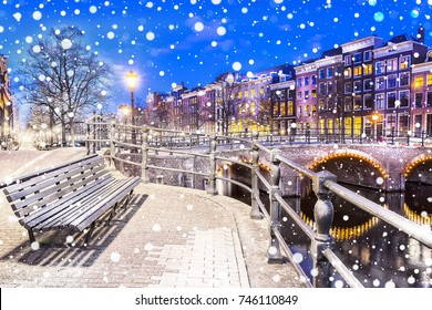 Bench at the canals in Amsterdam at night. Netherlands