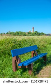 Bench with cornfield at Cape Arkona and Schinkelturm tower with the new lighthouse in the background in Putgarten on the island of Rügen