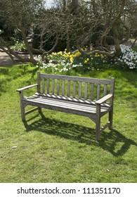 a bench in a country garden