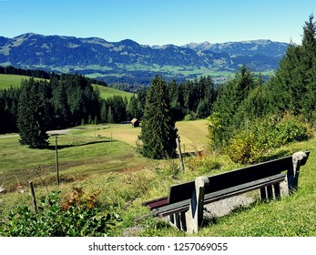 bench in front of beautiful bavarian mountains in allgau