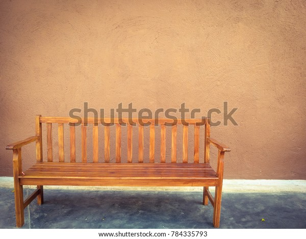 Excellent Bench Front Brown Painted Cement Wall Stock Photo Edit Now Evergreenethics Interior Chair Design Evergreenethicsorg