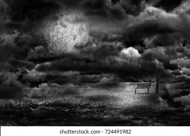 Bench in front of the moon in the night  between clouds