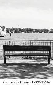 Bench in front of sailing boats in blackwhite