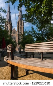 Bench in front of Saint Catherine's Cathedral church in Eindhoven, Netherlands