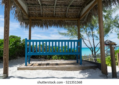 Bench in front of the sea under a gazebo.