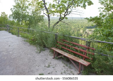 The bench is located along the tourist route on a high hill