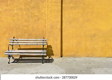 bench near Grunge aged texture street urban background yellow wall saver model shooting