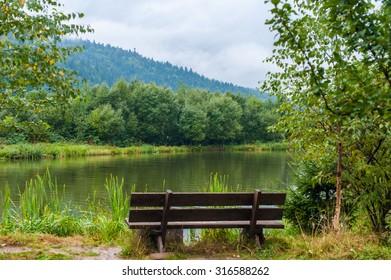 A bench near the mountain lake in the Carpathian mountains