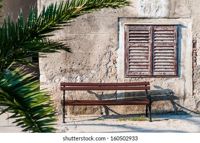 Bench and old window with shutters