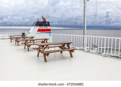 Bench on the ferry, cloudy day, white deck