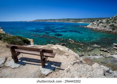 Bench on hill above sea in Cyprus