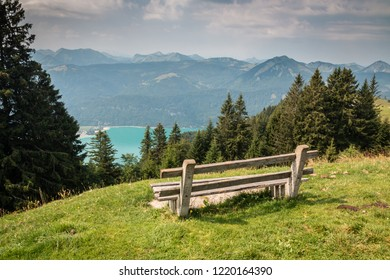 Bench on the hill with perfect view on the Alps